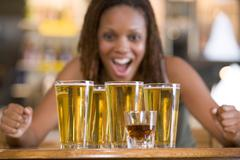 Woman posing with several beer glasses - stock photo
