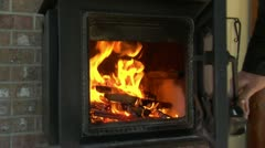 closing and opening woodstove door with fire - stock footage
