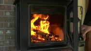 Closing and opening woodstove door with fire Stock Footage