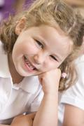 Student in class smiling (selective focus) - stock photo