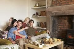 Young couples in cosy cottage Stock Photos