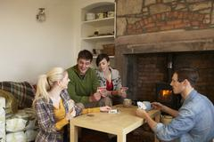 Stock Photo of young couples in cosy cottage