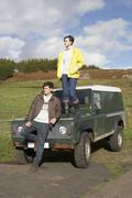 Young couple in countryside with suv Stock Photos