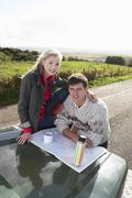 Young couple on country drive Stock Photos