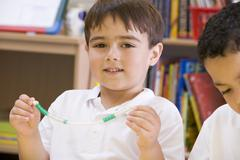 Student in math class with counting beads - stock photo