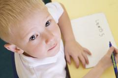 Student in class learning spelling (selective focus) Stock Photos