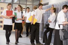 Secondary school students in a school hallway Stock Photos