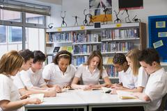 Students in a study group collaborating - stock photo