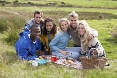 young adults on country picnic - stock photo