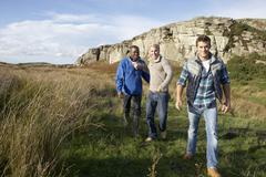 young men on country walk - stock photo