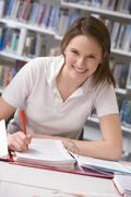Student writing and studying - stock photo
