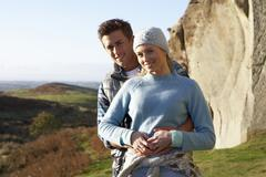 Young couple on country walk Stock Photos