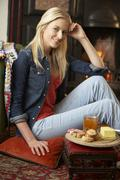 Young woman making toast on open fire Stock Photos