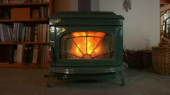 Nice woodstove with bookshelf nearby Stock Footage