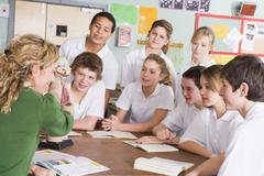 Students receiving a biology lesson in classroom - stock photo