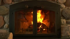 Fireplace behind glass doors Stock Footage