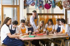 Students receiving art lessons - stock photo