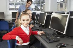 Stock Photo of girls using computers in school class