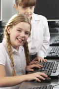 girls using computers in school class - stock photo