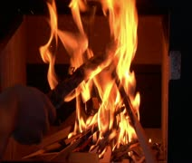 Starting fire in woodstove close-up Stock Footage