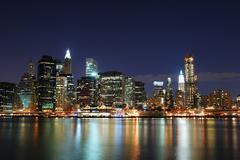 Manhattan at night in new york city Stock Photos