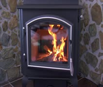 Kindling burning in woodstove Stock Footage
