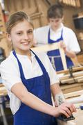 Female student learning woodworking Stock Photos