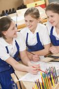 Female students learning woodworking Stock Photos