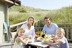 Stock Photo of family on vacation eating outdoors