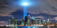 new york city manhattan skyline illuminated over hudson river - stock photo