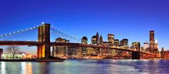 brooklyn bridge with new york city manhattan downtown skyline panorama at dus - stock photo