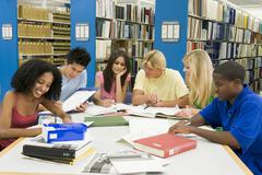 Six people in library studying Stock Photos