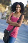 Women standing outdoors smiling (selective focus) - stock photo