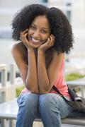 Woman sitting on bench outdoors smiling (selective focus) Stock Photos