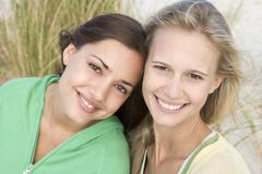 Two young women posing outdoors Stock Photos