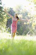 Woman jumping in a park Stock Photos