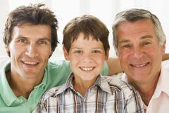 Grandfather with son and grandson smiling. Stock Photos