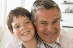 Grandfather and grandson indoors smiling Stock Photos