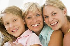 Grandmother with adult daughter and granddaughter - stock photo