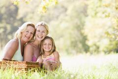 Grandmother with adult daughter and grandchild on picnic Stock Photos