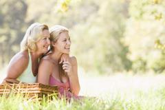 Mother with adult daughter on picnic - stock photo