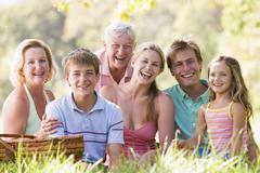 Family at a picnic smiling - stock photo