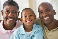 Grandfather with adult son and grandson - stock photo