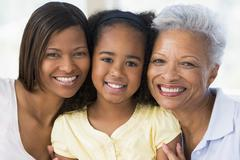 Grandmother with adult daughter and grandchild - stock photo