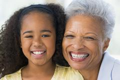 Grandmother and granddaughter smiling Stock Photos