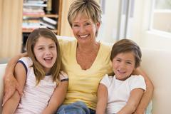 Grandmother posing with grandchildren. - stock photo