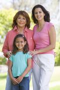 Grandmother with adult daughter and grandchild in park Stock Photos