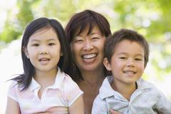 Grandmother laughing with grandchildren. - stock photo