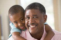 Grandfather and grandson smiling Stock Photos