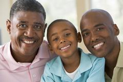 Grandfather with adult son and grandchild Stock Photos